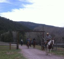 A group of guests comes back from their first ride at southern Colorado dude ranch Rainbow Trout Ranch