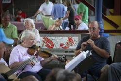 A photo of musicians performing at Shreveport Farmers' Market