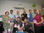 Conexus employees and piles of supplies.