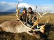Eva Shockey and Rachelle Hedrick of Smoke Hole Outfitters posing with a reindeer during a hunting trip in Alaska.