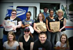 Resolution Systems, Inc. Team Joins the Salvation Army of Greensboro for the 'Stamp Out Hunger' Campaign