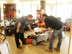Al Clayman going over proper use of a Husqvarna Mower