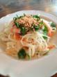 Green Papaya Salad topped with shrimp, mint leaves and crushed peanuts