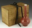 Red Glazed Vase with Qing Qianlong mark on base.