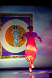 Jeannine Goode-Allen dancing in front of Hildegard painting