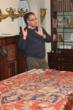 Arash explains the history of rug weaving