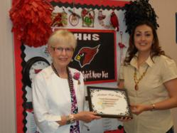 Gail Thomason of HFD receives award from Harlingen High School Counselor Alicia Moore