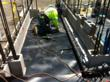 Courteny Waterproofing employee installing HDPE at one of the Port of Los Angeles Police Department K9 building dog runs.