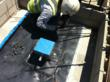 Courtney Waterproofing employee installing a steel pipe clamp at a pipe penetration
