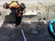Courteny Waterproofing employee installing a termination bar at the edge of footing