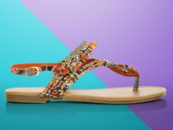 City Classified Women's Colorful Beaded Sandals. Color your world with the City Classified Maty flat sandals! With a watercolor printed fabric upper, gold metal detailing and beautiful beaded accents, these stylish sandals will add the perfect personality