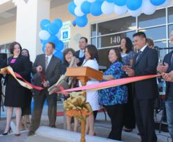 Rep. Naomi Gonzalez, D-El Paso, joins Frank Heyliger, WellCare's Southwest Region President and WellCare employees for the grand opening of WellCare's El Paso Welcome Room.