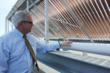 David Small inspects the solar thermal system on the Cliff Spa rooftop
