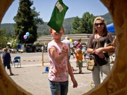 A child has perfect aim at the bean-bag-toss during last year's Open House and Carnival at the Children's Museum of the Sierra in Oakhurst. This year's event takes place June 15.
