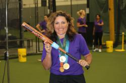 Lisa Fernandez showing off the Fast Pitch Hitting Jack-It Training System