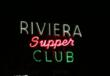 The Riviera Supper Club's famous neon sign illuminates the night sky