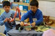 Boys having fun setting up their own story theater, using baben made from all-natural wool