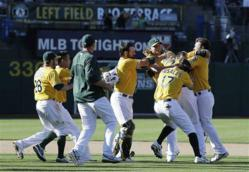 The A's celebrating their victory against the Yankees