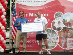 Brandon Lau, WellCare of Kentucky, left, presents WellCare's Team Red sponsorship check to Jerry G. Hale, ADA Step Out Corporate Chairman on Saturday, June 1, 2013.