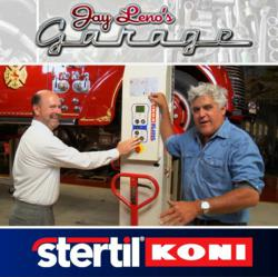 Jay Leno with Carl Boyer, Stertil-Koni sales manager, operating  Stertil-Koni Wireless Mobile Column Lifts