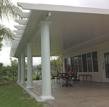 A pergola-style patio roof from Venetian Builders, Inc., Miami. The roof is all aluminum for low maintenance and long life.