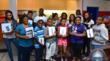 Temeko Richardson poses with youth from Ray's Kids of Character program who won technology prizes donated by Run Life's Course