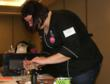 Sarah Myers of High Five Cakes demonstrates the Sweet Accents Cake Designing machine at the Ohio Day of Sharing.