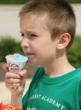 Kevin Dillenburg, 2nd grader from Lemont, enjoys a snow cone break from the games