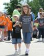 Rachel Yep, 3rd grader from Homer Glen, assists her brother Michael, incoming kindergartener, with his relay