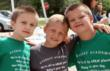 2nd grader, Kevin Dillenberg of Lemont, Gavin Lambert of New Lenox, and Lucas Hagedorn of Lemont, celebrate a year of friendship at Everest Academy's Field Day games.