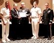 SIA CEO Don Erickson (center) receives the ESGR Above and Beyond Award from, left to right, Capt. Marcus Cromartie; Virginia ESGR Chairman Stephen Villalpando; Rear Adm. Bryan Cutcheon; and Major Gen. Daniel Long, Jr.