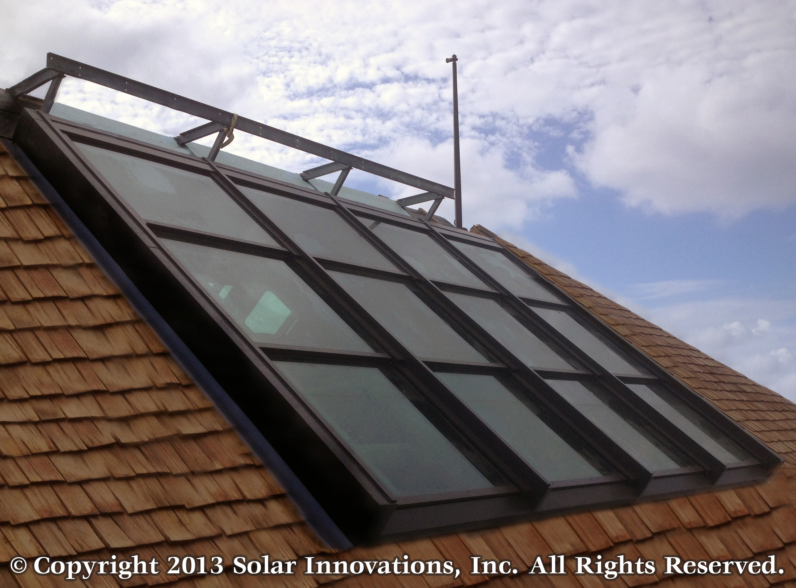 Solar innovations inc s unveils multi panel retractable for Greenhouse skylights