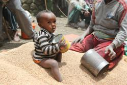 Ethiopian Child and Mother Receiving U.S. Food Aid