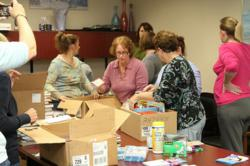 Seaside Heights E. A. members prepare materials for displaced school libraries including their own.