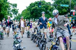 Athletes in business attire racing to their folded Brompton bicycles as U.S. Championship race starts