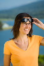 Lady wearing Cocoons Photochromic Polarised Sunglasses