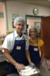 Kelson Carter, Plumber & Bridgette Hardamon, Marketing Intern serve lunch to the homeless