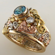 Celtic ring with diamonds and blue zircon