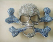 Jewelry piece of a crystal skull with blue crystal crossbones