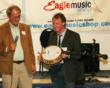 Steve Noon, Eagle Music founder being presented with the very first Eagle II banjo