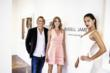"RUSSELL JAMES, model LINDSAY ELLINGSON, and opening night reception host ADRIANA LIMA at James' ""A Short-Lived Tyranny"" exhibition At 212 Gallery, Aspen (Photographer: Nick Tininenko/Getty Images)"