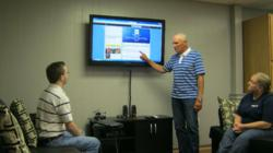 Eddie Clark providing feedback to DeRisk IT Inc. team members
