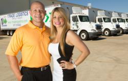 Juan Arango and Sol Arango stand in front of their new truck fleet.