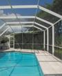 A screen pool enclosure from Venetian Builders, Inc., Miami. Heavier-gauge framing retains its elegant look but adds strength.
