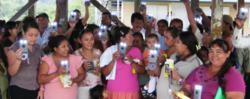 A Village recieves their WakaWaka Solar Lights from the Grid Earth Project.