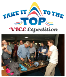 Austin Lines talks to KMC Systems employees about the Take It To The Top expedition.