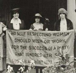 Alice Paul and other women's rights supporters of the 1920s hold up a flag with a quote by Susan B. Anthony.