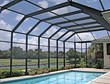 A screen pool enclosure from Venetian Builders, Inc., Miami. Heavier-gauge framing looks elegant but adds storm resistance.
