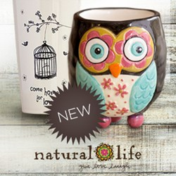 Photo of two Natural Life Mugs with a New burst and Natural Life Logo