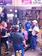 Bill Wenzel (R) explains welding certification to high school students.
